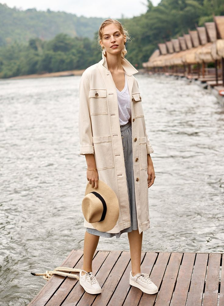 madewell cline duster coat worn with whisper cotton v-neck pocket tank, palisade button-front midi skirt, tassel statement earrings + tretorn nylite perforated platform sneakers.