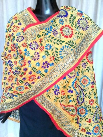 This beautiful phulkari dupatta on handloom chanderi fabric has been hand embroidered with wool thread and sequins. A graceful and stunning accessory for your evenings out - See more at: http://giftpiper.com/Phulkari-Dupatta-Handmade-Chanderi-yellow-id-830065.html. Also see our famous dupatta collection at -http://giftpiper.com/Stoles-Dupattas-catid-36678-page-1.html