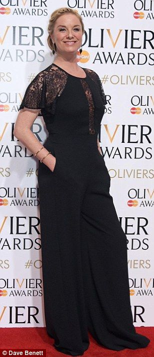 Classic in black: Tamzin Outhwaite showed off her sleek fashion credentials in a flared jumpsuit, which had short lace sleeves and a semi-sheer panel along the bodice