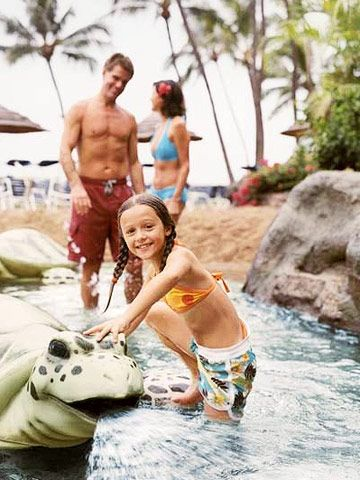 An activity-packed children's pool with a sand island in the middle, plus a kids-eat-free promotion this summer, make this resort a relative bargain on one of the most expensive Hawaiian islands.