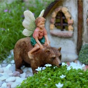 Add charm and whimsy to your fairy garden with this delightful fairy boy and his pet bear!