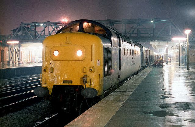 """55010 (D9010) """"THE KING'S OWN SCOTTISH BORDERER"""" waits at Doncaster on the evening of Friday 30th October 1981 with the 1A34 20:19 York - King's Cross service. (Paul Bettany)"""