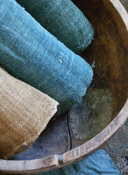3 rolls of Japanese Hemp Kaya (mosquito netting). Kaya is usually produced in this family of colors: undyed, indigo dyed, and indigo (over dyed with a yellow dye - roll on right). Nested in an old, hand-hewn and repaired Korean wooden bowl. (SRI Threads Blog, Stephen Szczepanek}