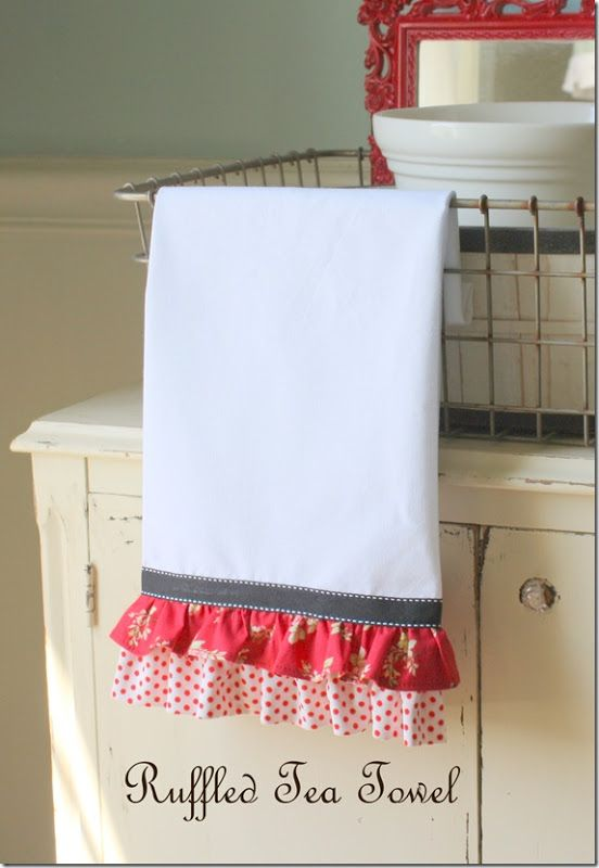"""Ruffled Tea Towel - The designer said: """"I cut the fabric into two long strips (about twice the width of the towel). Each one is about 1 1/2"""" to 2"""" wide. I gathered each one separately, and then stitched them to the towel. I stitched the bottom one on first, then pinned the top one so that it would overlap the polka dot ruffle slightly. I then sewed the ribbon across the top raw edge of the floral ruffle."""""""