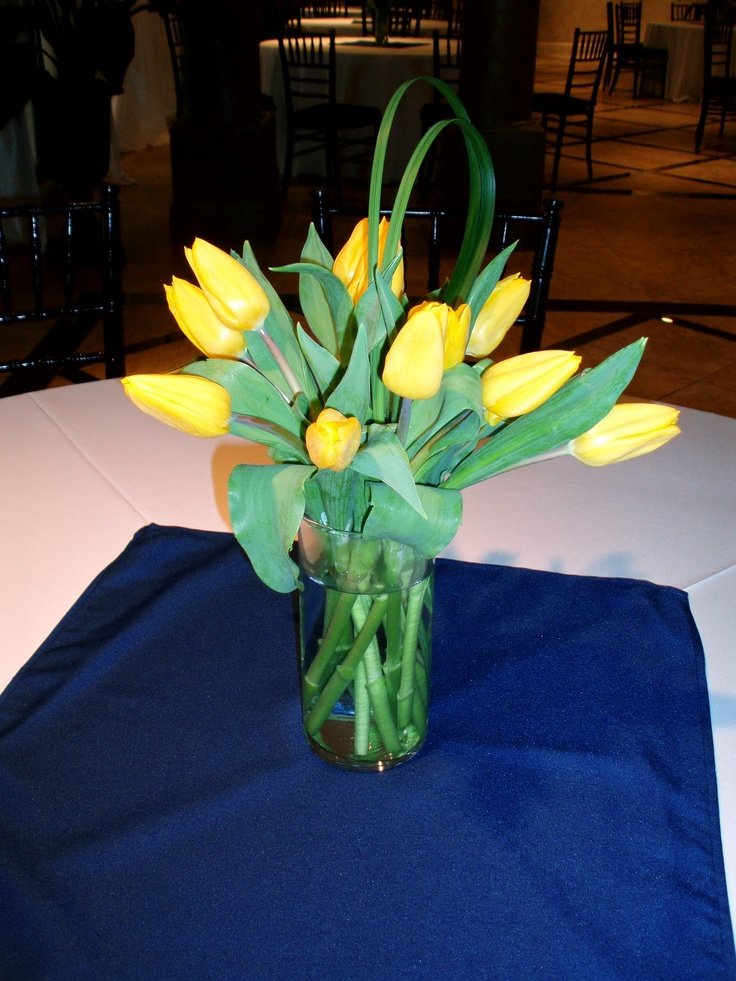 yellow tulip centerpiece for a yellow and navy blue wedding