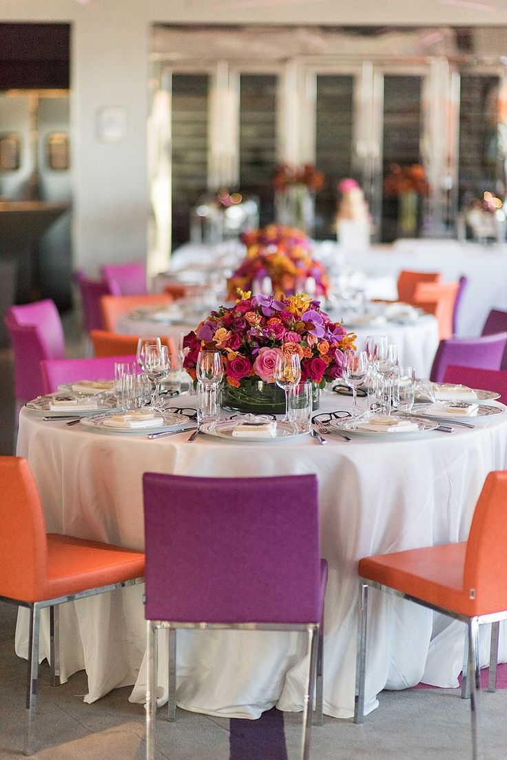 Purple and Orange Tablescape. Low Round Centerpiece. Pink, Orange, and Purple Roses and Purple Orchids | Event Planning & Floral Design: tracytaylorward.com | Photography: www.laurenlarsen.com | Venue: Robert Restaurant, New York