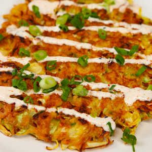 How to Make Cabbage Okonomiyaki | This savory, Japanese-style pancake is traditionally loaded with cabbage. Louis' version uses quickly brined cabbage and a thin batter for maximum crispiness. Togarashi (also called Japanese Seven Spice) is available at Asian markets.