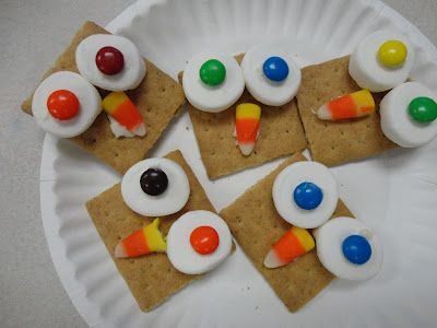 Owl snack...marshmellow, graham crackers, candy corn & m easy!