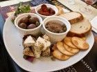 Typical Maltese platter, bread, water biscuits, bigilla, cheeslets, olives, sun dried tomatoes  enjoy !!