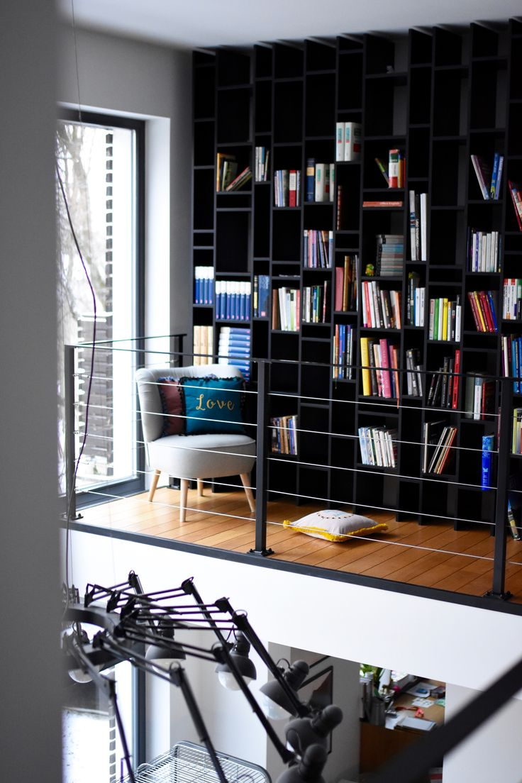 Cushion decoration in perfect interior. Books shelving system with perfect few.