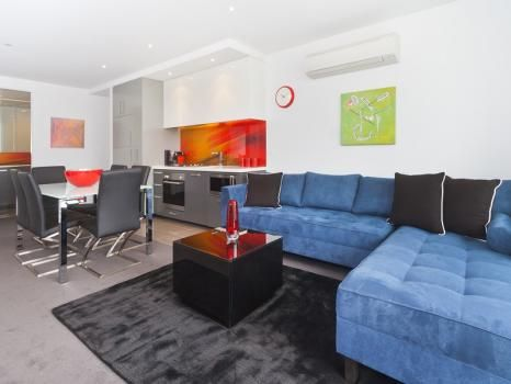 509/87 High St, Prahran, Melbourne - The apartment boasts views of the Melbourne CBD skyline from both the open plan kitchen and living area, with entertainer's balcony, and from the master bedroom with queen bed, built-in-robes and ensuite. The second bedroom has 2 single beds, and the european laundry includes washing machine and dryer. There is also a secure undercover car park downstairs.