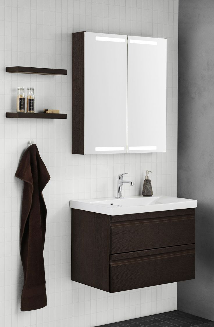 nice layout with the warm coffee colour integrated handles and spacious mirror cabinet combine bathroom