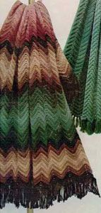 The Crocheted Zig Zag Afghan is a classic crochet ripple pattern done in natural reds, greens, and browns.