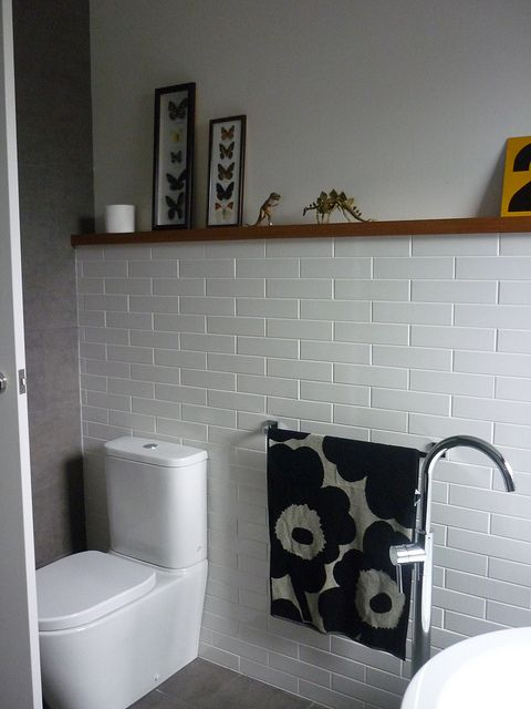 Kids' bathroom - I love having a shelf there so it's warmed up with our/kiddies things
