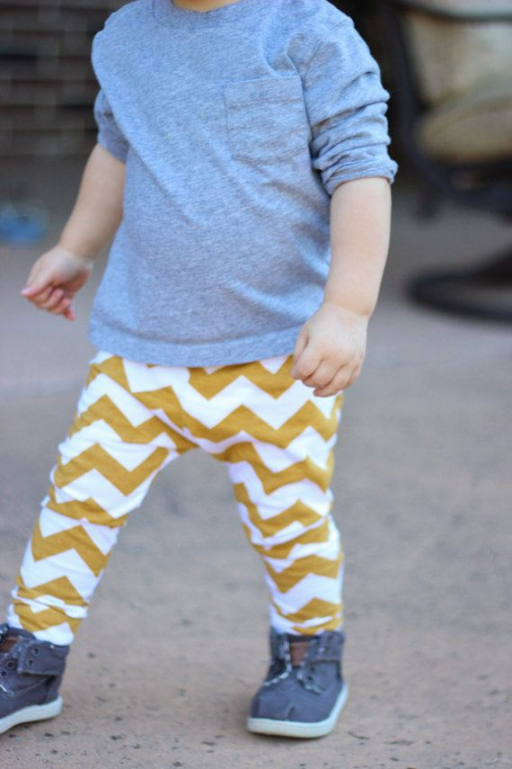 A fun patterned pair of baby boys' leggings dresses up a plain shirt or onesie. Some pairs have simple patterns, such as stripes and polka dots. Others are more playful, featuring hot air balloons, animals, or mustaches. Design mixing.