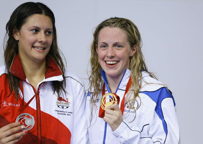 Aimee Willmott of England with the silver medal, left, and Hannah Miley of Scotland, right, holds the gold medal during the medal ceremony after the Women's 400m Individual Medley.
