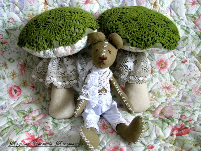 Small bear in green mushrooms...