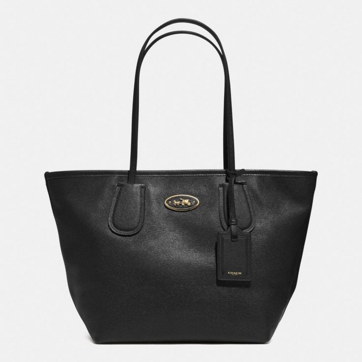 The Coach Taxi Zip Top Tote In Leather from Coach