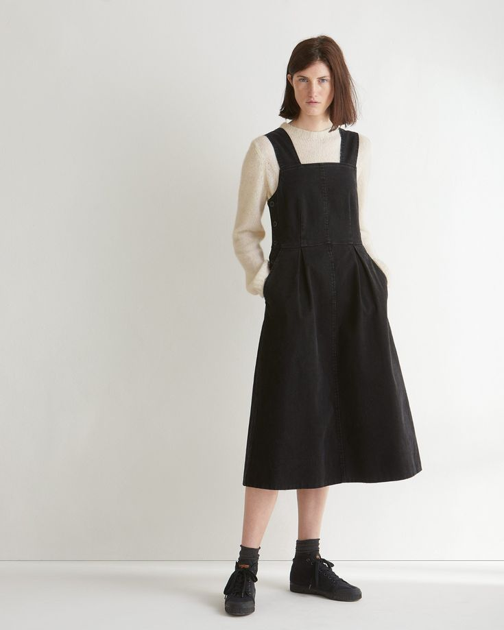 COTTON TWILL FITTED PINAFORE DRESS | Soft, peachy cotton twill with stretch. Fitted bodice. Pleated skirt. Wide straps, Buttons to fasten right side. Pockets. Corozo buttons. Mid-length.