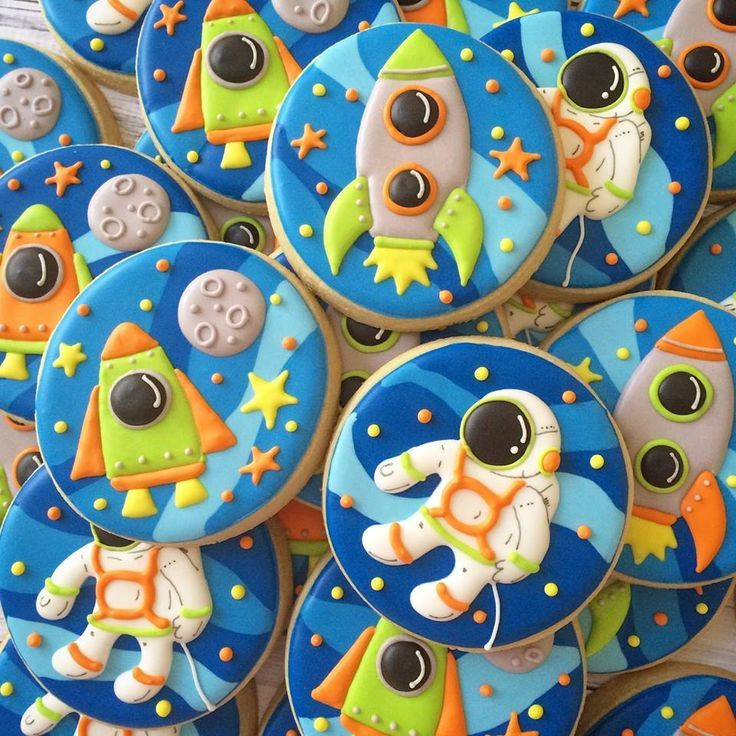 Outer Space Decorated Sugar Cookies with an Astronaut and Rocket