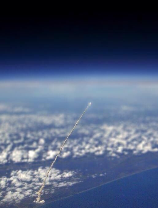 Shuttle launch photographed from space