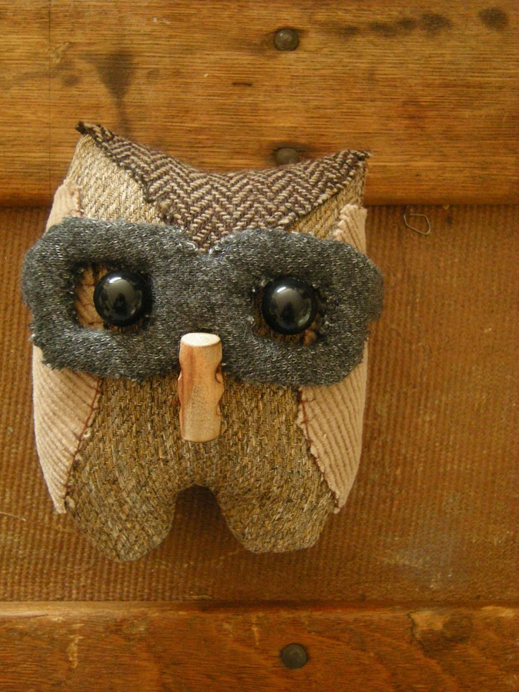 Oscar the owl is 4 inches tall and 3 inches wide he is 100% recycled material and handmade.    I once was a.......2 pairs of dress pants, skirt and a belt.    but now I'm your.......mini owl!