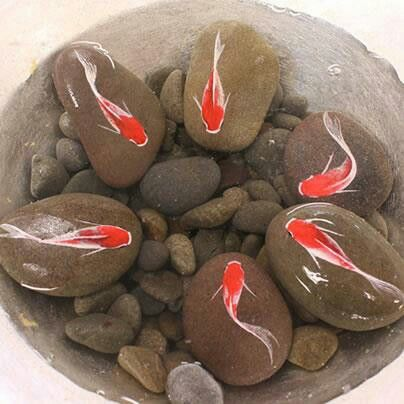 Koi painted on rocks.