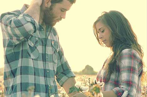cotton field and flannel shirt engagement pictures.