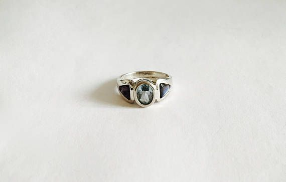Sterling Silver Setting with Faceted Oval Cut Bezel Set Icy