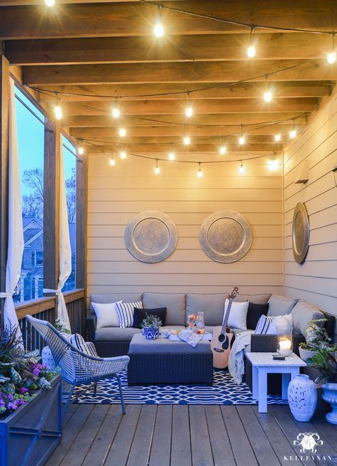Twinkle lights on the back porch- cozy outdoor living