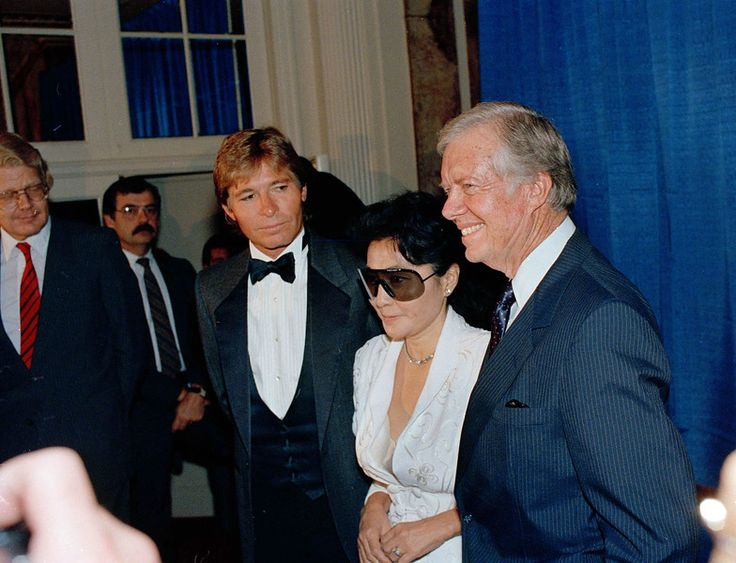 Former President Jimmy Carter, right, is joined by Yoko Ono, center, and singer/songwriter John Denver at New York's Waldorf Astoria Hotel.