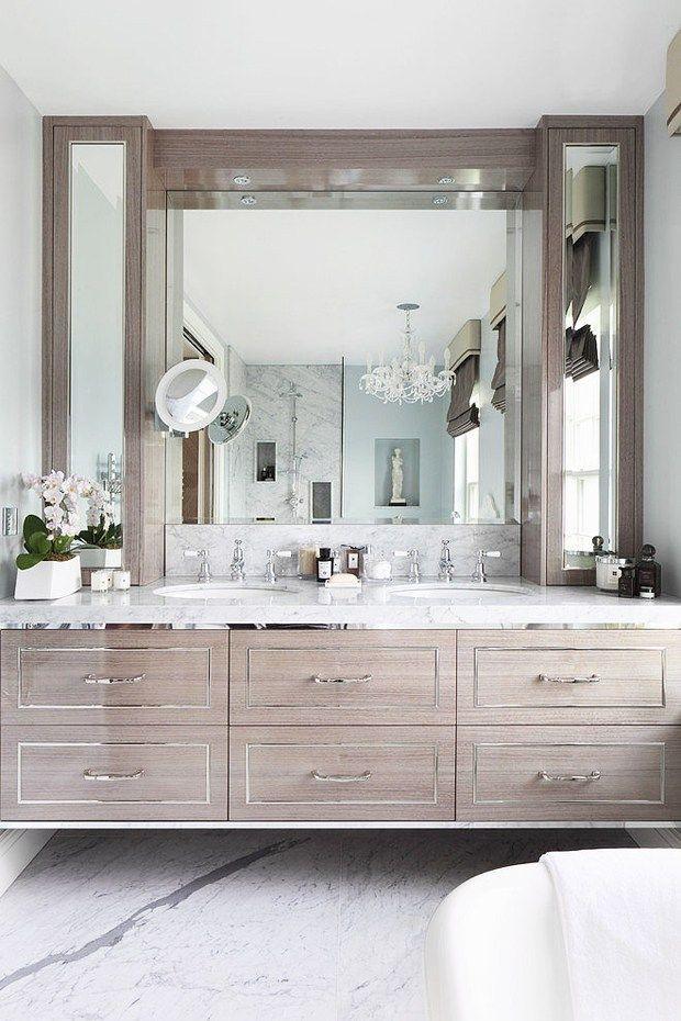 Bathroom with a glamorous oak and chrome floating vanity designed by Oliver Burns, via @sarahsarna