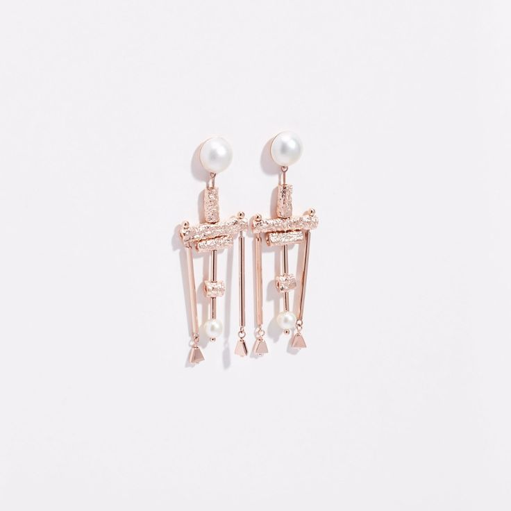 Inspired by new wave music and long nights on the dance floor, Lucy Folk's Talking Head's Earrings play with texture and tone. Contrasting two Marbay pearls and two fresh water pearls against a series of textured and high shine rods, available in a selection of plated metals, these handmade earrings make a bold statement with a masculine twist.