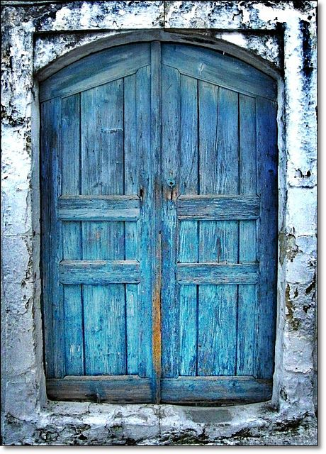 Blue door on old building in Crete, Greece.  Photo by Eleanna Kounoupa.