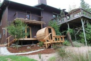 Thank you to David and Arlene from Seabeck, WA for this beautiful photo of their new Almost Heaven Barrel Sauna!