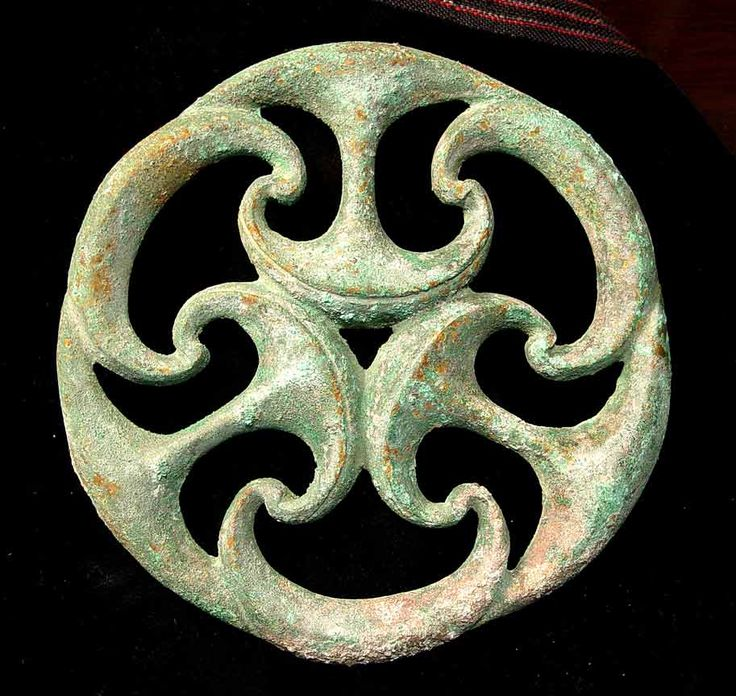 CHOICE CELTIC CHARIOT ORNAMENT, c. 1st -3rd century AD. Large bronze decorative ornament of classical Celtic style. Rust from iron attachment tenons on reverse. Intact and very rare. A beautiful Celtic piece!