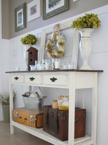 Add a lower shelf to a basic console table to keep clutter off the top surface and create more space for your everyday items. Use vintage suitcases to contain the mess below.