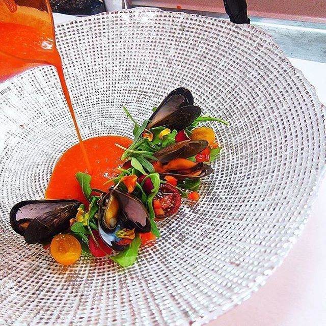 Mussels casino, saffron tomato broth, baby arugula. ✅ By - @nufaceoffood ✅ #ChefsOfInstagram