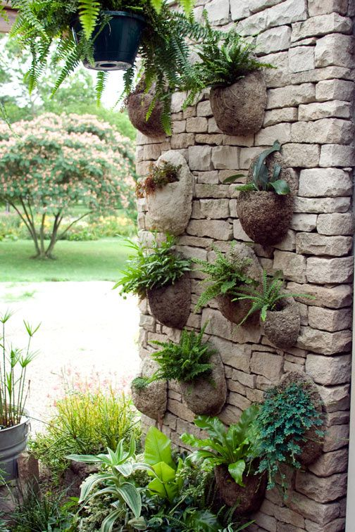 Nice idea hypertufa wall pots. Would like to try this with coconut shells too.