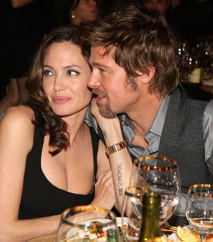 Pin for Later: 31 Times Brad Pitt and Angelina Jolie Showed Their Love For Each Other (and the Cameras!)  In January 2008, Brad cozied up to Angelina at the Critics' Choice Awards.
