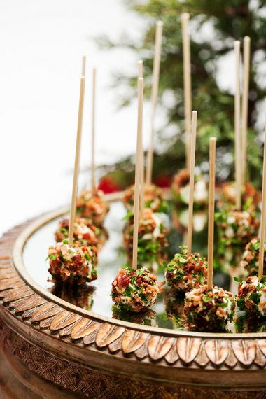 goat cheese and bacon balls with sun dried tomatoes and fresh basil....