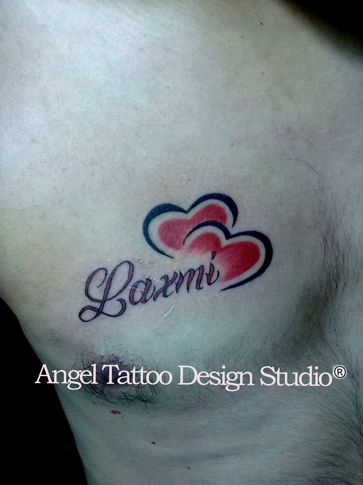 Laxmi Name Tattoo With Red Colour Hearts Made On Chest At Angel Tattoo Design Studio Gurgaon Name Tattoo Angel Tattoo Designs Tattoo Designs