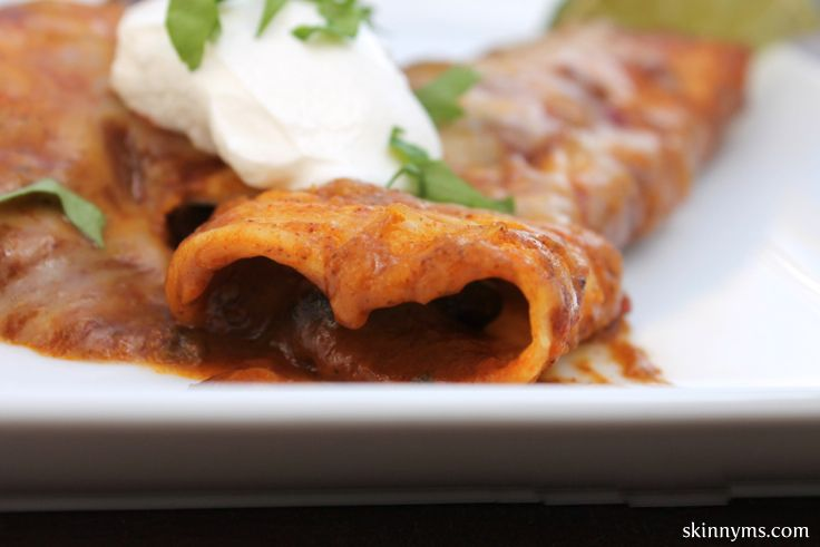 Filled with a savory mix of onions, black beans, and reduced fat cheese, these Slow Cooker Vegetarian Enchiladas are delicious. #skinnyms, #enchiladas, #crockpot