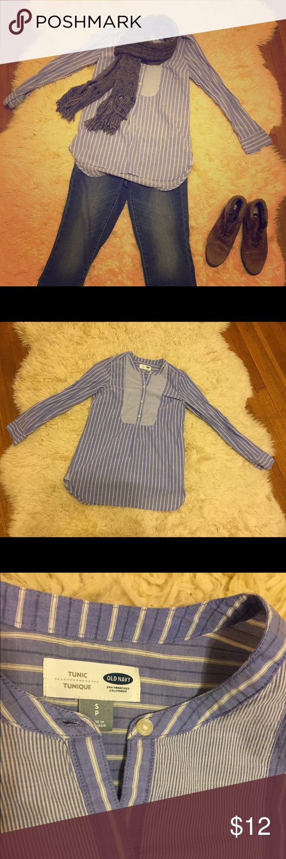 "Striped Periwinkle Tunic Top This tunic top has a beautiful periwinkle color, flattering pinstripes, a ""tuxedo"" front with buttons, and long sleeves that are easy to roll up. This is the perfect top for some jeggings or skinny jeans, or for tucking into a high waisted skirt. Soft and floaty, this will the perfect addition to your Spring wardrobe. EUC! Worn only once! Says size small, but it would fit a size medium or large. Body: 26""/ Sleeves: 23"" Old Navy Tops Tunics"