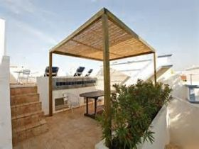 Roof patio, Tavira, Portugal – Best Places In The World To Retire –If you are moving your things to Portugal, it is best not to bring your electrical appliances because we have a different voltage here in Portugal than in the US. We use 220 voltage here, which is the same as in England.