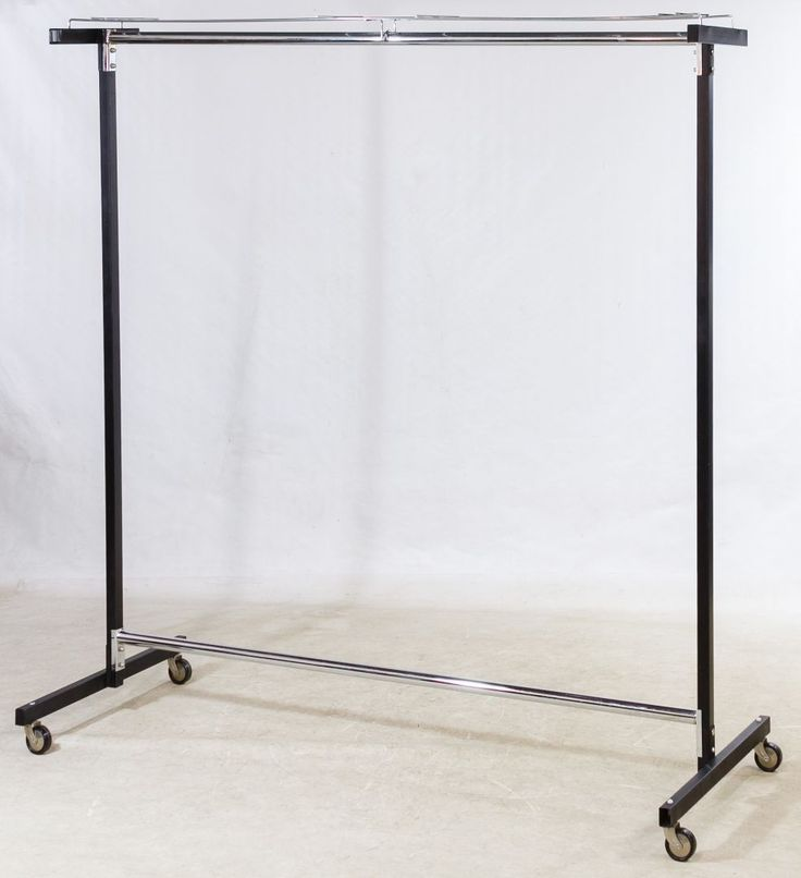 Lot 696: Metal Clothing Rack; Comprised of two black metal upright poles, two wheeled castor parts, a chrome rack and two chrome hanger bars