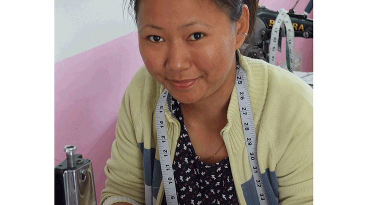Our designer Frances, with Namgyal, our tailoring centre manager, announcing the tailor of the month...Pema!! Find out more and meet our tailors at http://www.eternalcreation.com/pages/himalaya-tailoring-centre