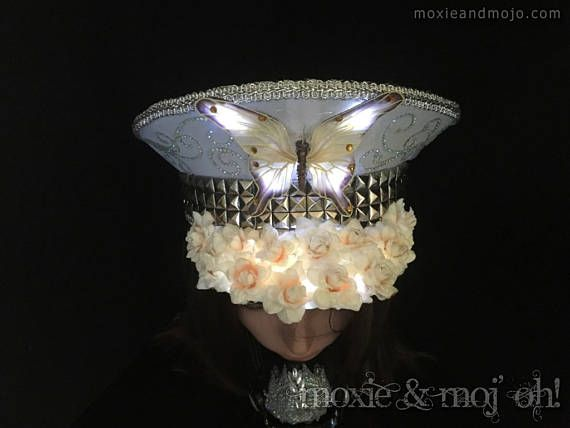 Military style, light-up, Captains hat ~ Butterfly In Bloom - perfect for the playa. The beautiful butterfly not only looks beautiful as an eye catching centerpiece atop a field of flowers in bloom... but yes, it lights up and so do the flowers! White LED fairy lights illuminate the flowers at the four wing points of the butterfly when turned on ~ gorgeous wear for day and night! ***************************************** Hat Specifications: Size: Small Hat Sizing: 19-22 Gender: unisex *will…
