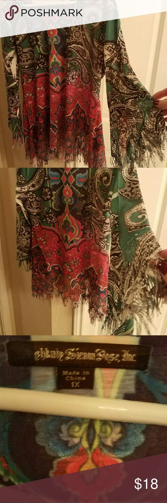 Paisley fringed blouse From Steinmart's boutique area...this is a gorgeous blouse. Accompained by bell sleeves and fringe.Worn once. Looks great with Jeggings and cowgirl boots. Tops Blouses