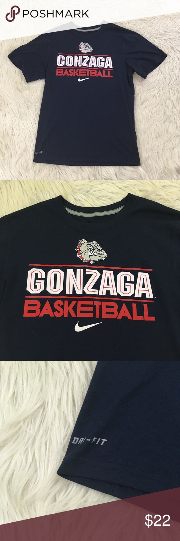 "NWOT Nike Gonzaga University Basketball T-Shirt NEW WITHOUT TAGS! Nike Mens Small Gonzaga University Basketball Dri Fit Shirt. Never worn.  Length; 27"" Armpit to armpit: 20.5""  📌NO lowball offers 📌NO modeling 📌NO trades  Come check out the rest of our closet! We have various brands and ALL different sizes! Nike Shirts Tees - Short Sleeve"